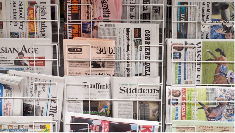 proofreading-newspaper-stand-min