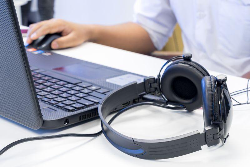 transcription-services-laptop-headphones-min